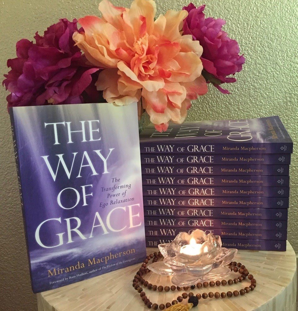 A stack of Miranda's book: The way of grace. Beautiful bouquet of pink flowers